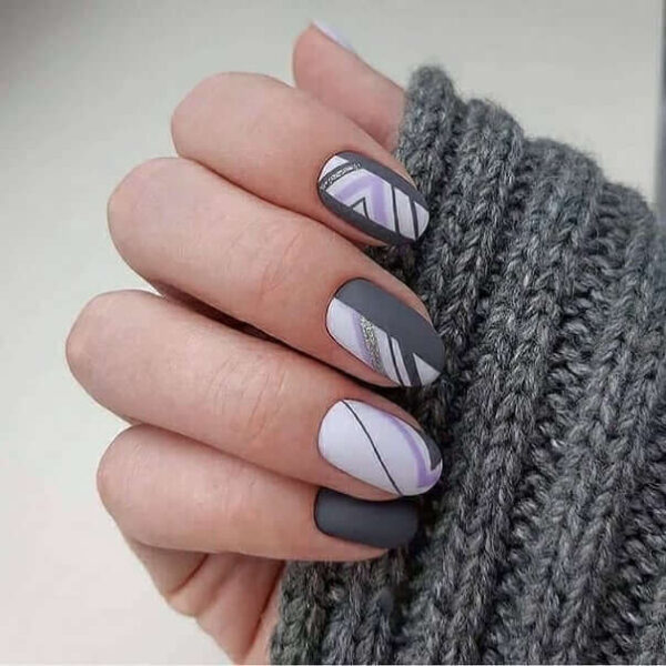 Gray manicure with stripes