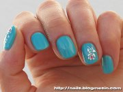 teal nails with flowers