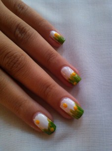 Step 4: Use a large dotting tool dipped in yellow, keep random dots on your nails.