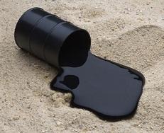 Oil spilling onto sand