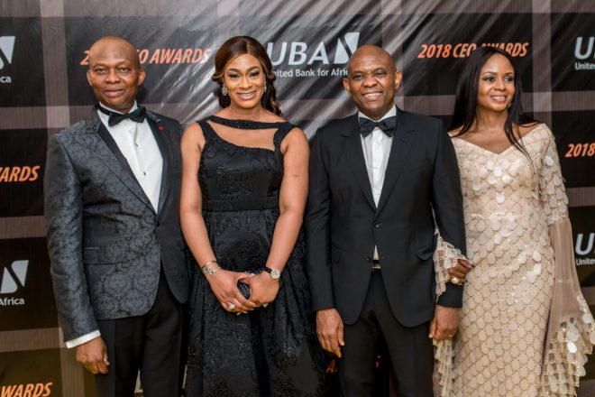 L-R: GMD/CEO, UBA Plc, Mr Kennedy Uzoka and wife, Lotanna; and Group Chairman, UBA Plc, Mr. Tony Elumelu and wife, Awele, at the 2018 UBA CEO Awards