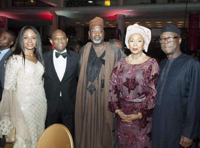 Group Chairman, UBA Plc, Mr. Tony Elumelu and wife, Awele; Deputy Managing Director, Total E&P Nigeria, Alhaji Ahmadu-Kida Musa; and Former Governor of Ekiti State, Otunba Niyi Adebayo and wife, Angela, at the 2018 UBA CEO Awards