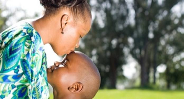 African mother kissing her boy child