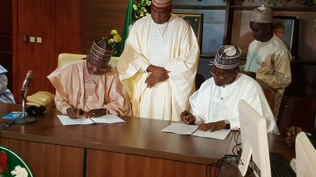 L-R: The Executive Governor, Katsina State, Aminu Bello Masari and Group President/CE, Dangote Group, Aliko Dangote, at the official signing and handing over ceremony of Songhai Project to Dangote