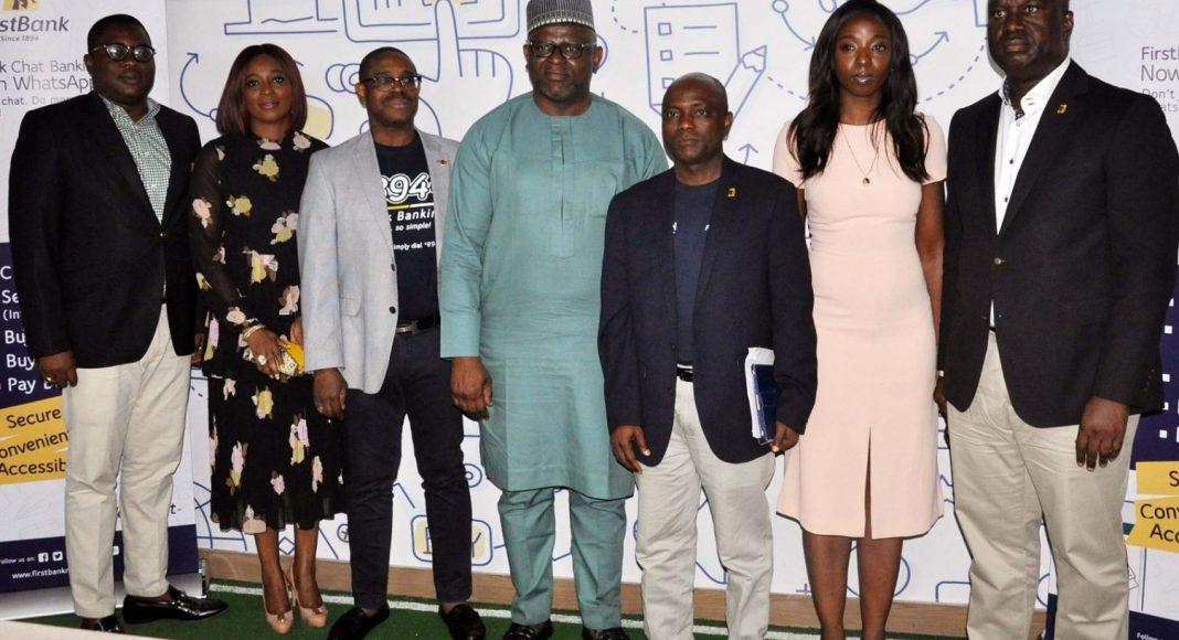 Adesola Adeduntan, Managing Director/Chief Executive Officer, FirstBank (centre); flanked by Gbenga Shobo, Deputy Managing Director, FirstBank (third left); Folake Ani-Mumuney, Group Head, Marketing & Corporate Communications, FirstBank (second left); Adebayo Olanrewaju, Head, Digital Banking, e-Business, FirstBank (extreme left); Olusegun Alebiosu, Chief Risk Officer, FirstBank (third right); Lola Ekugo, Head, Digital Lab, e-Business, FirstBank (second right) and Chuma Ezirim, Group Head, e-Business Group, FirstBank (extreme right) at the formal launch of the FirstBank Chat Banking on WhatsApp held at the FirstBank Digital Lab, Yaba, Lagos.