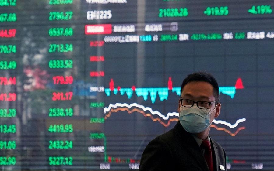 Global stocks tumble on
