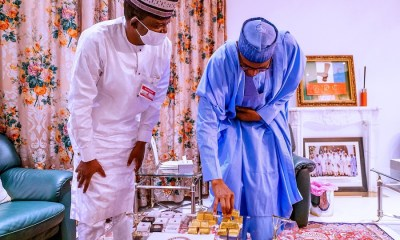 Buhari presented with gold bars mined in Zamfara as Nigerian prepares to launch PAGMI scheme.