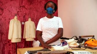 "Integrating each outfit For designers like Sophie Zinga, photographed here at her workshop in Dakar, the task is clear: ""As a fashion designer I think we are going to have to integrate each outfit with fashion masks."""