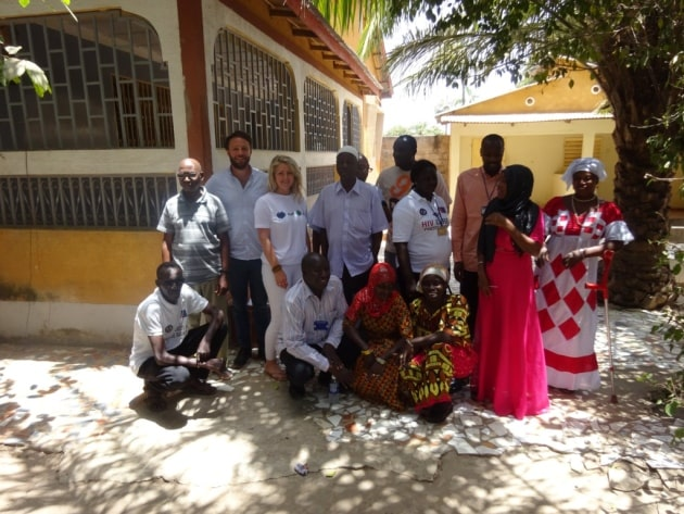 Origin founders Alice and Tom Cracknell with a HIV support group in Gambia.