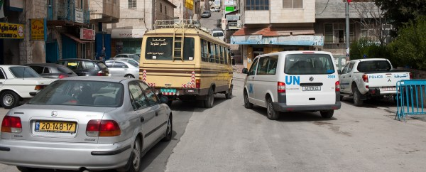 Cars in the West Bank -- with Israeli (yellow), Palestinian Authority (green), and international (white) license plates (photo by Ridvan Yumlu, CC license).