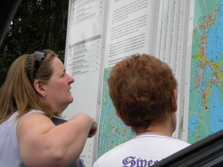 mother and daughter looking on a map