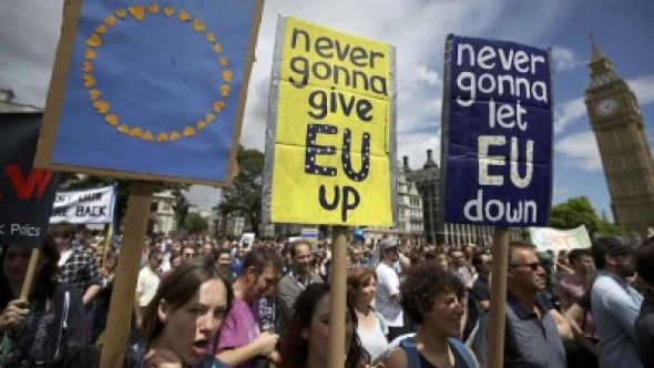 Protestors hold banners in Parliament Square during a 'March for Europe' demonstration against Britain's decision to leave the European Union, central London