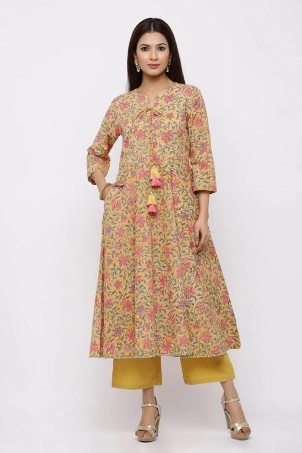 Mustard floral printed kurta set with tassel detailing.