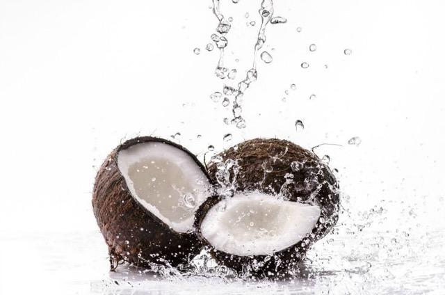 cracked coconut splashing in water