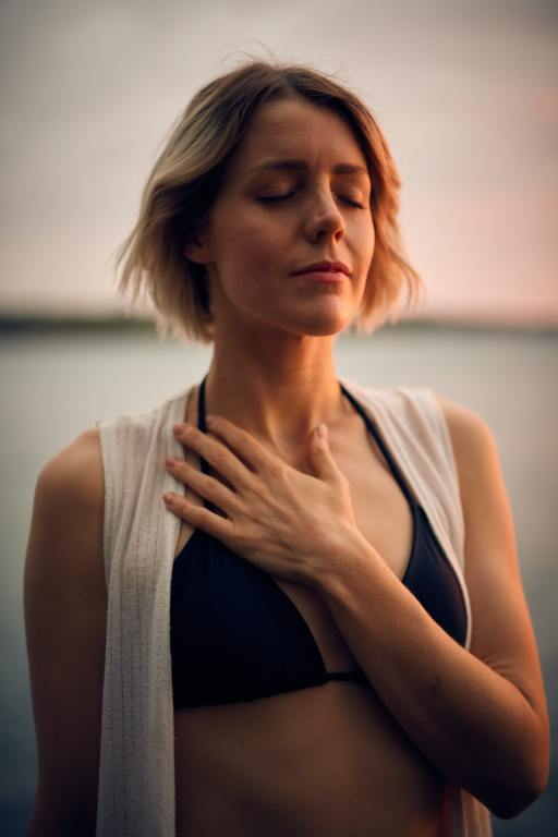 woman meditating with eyes closed and hand over heart