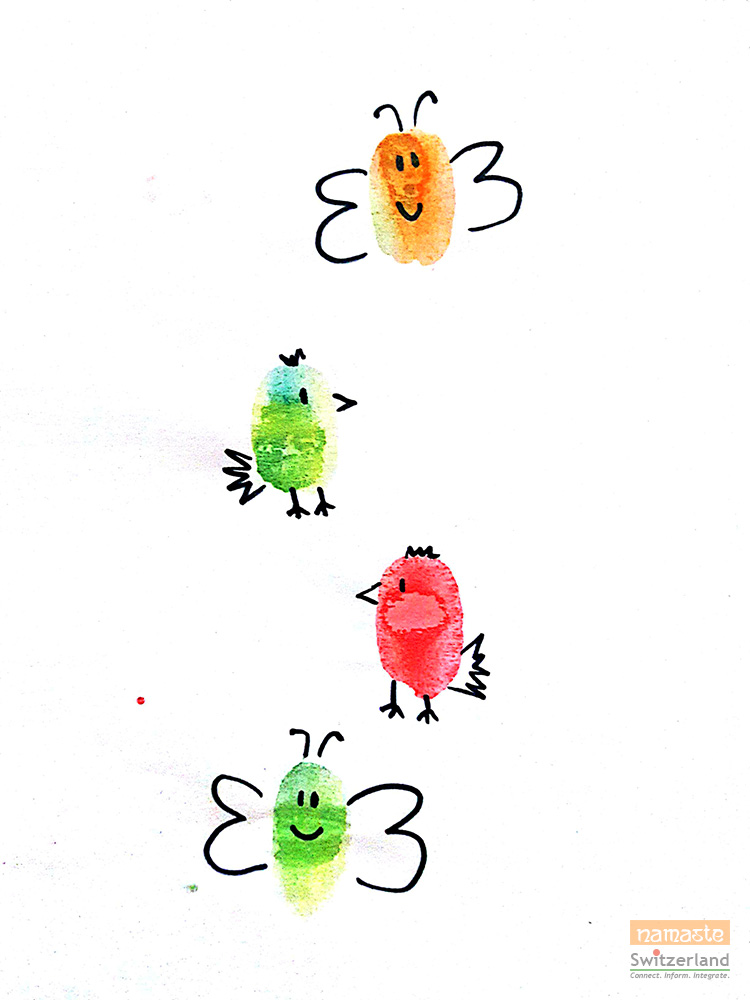 Painting birds and butterflies with thumbprints