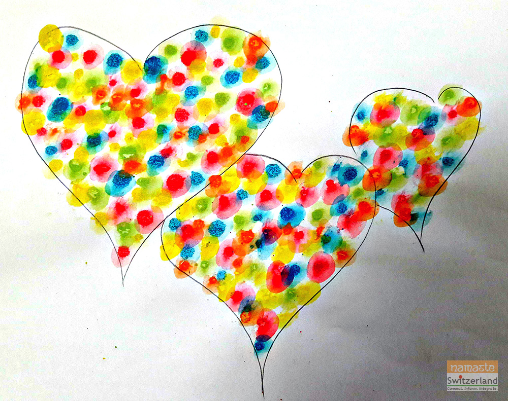 Painting hearts with thumbprints