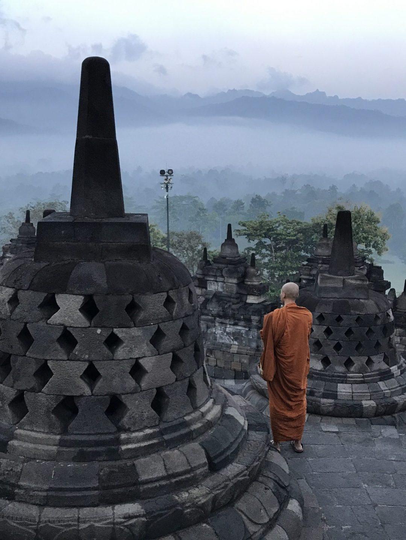 A Buddhist Monk Watching the Sunrise at Borobudur Temple