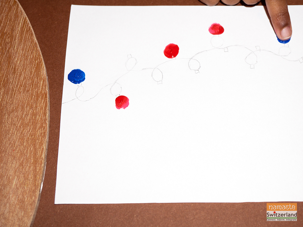 Photo of Step 1 of Christmas Lights Finger Painting Card