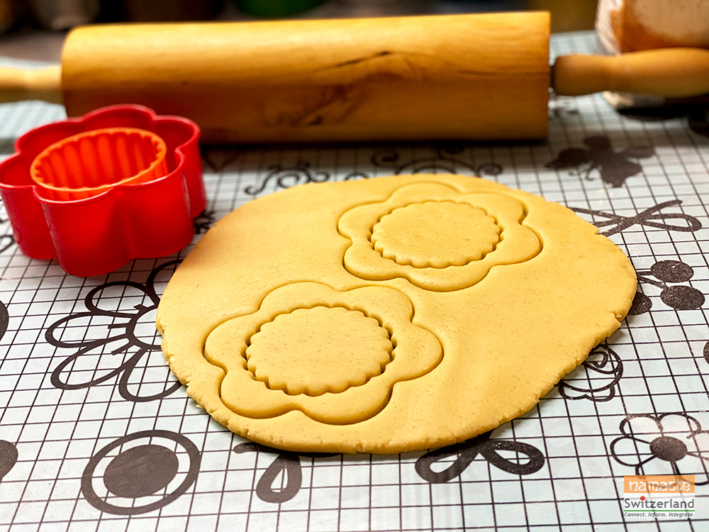 Photo of rolling and cutting cookies