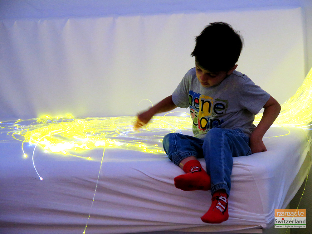 Photo of an autistic child in a Snoezelen Room