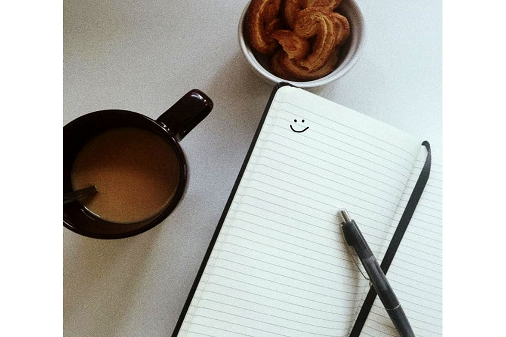 Image showing a work diary ,tea-and-biscuits