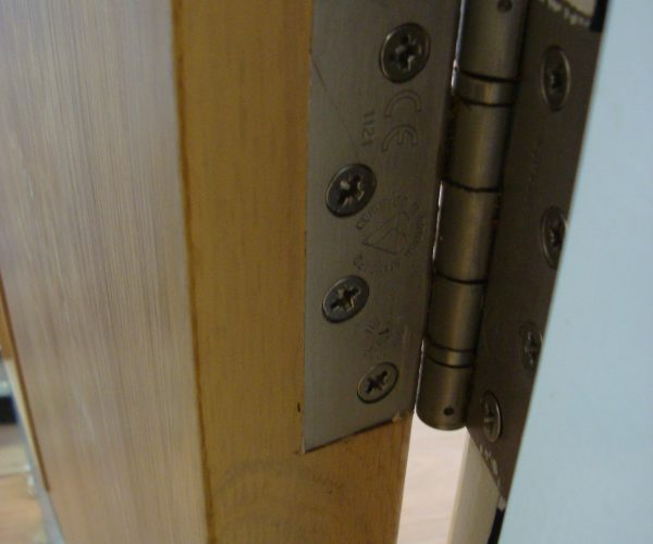 Hinge cut incorrectly to veneer door repair