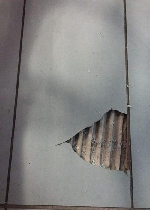 damaged floor tile repair