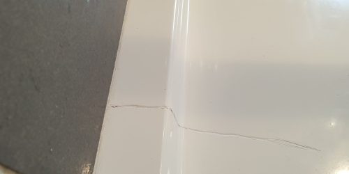 BADLY CRACKED SHOWER TRAY REPAIR MANCHESTER BEFORE