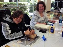 Dale Burgei (grandson) and Carol Walls working on their ski lodges.