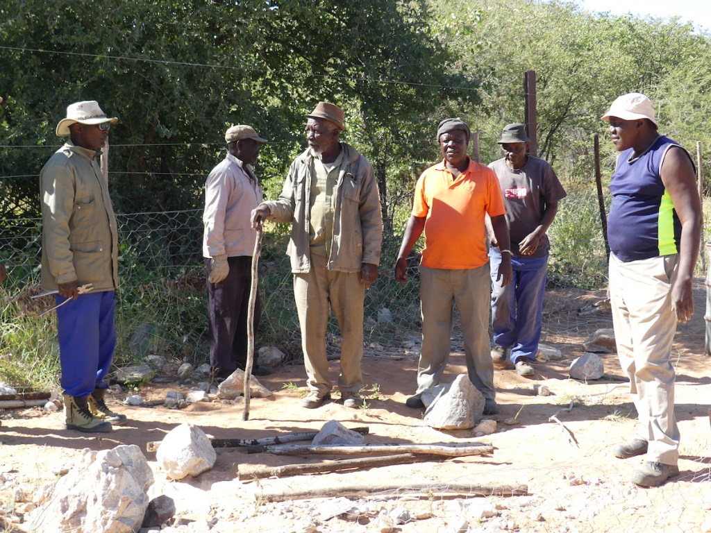 Communities fixing the etosha fence with help from Namibian Lion Trust