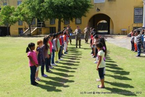 The girls and boys of Westcott Primary receive instruction on how to form a guard of honour for the functionary