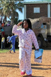 This young lady, still in her PJs and slippers, gives a neat salute to Colonel Elsa van Wyk