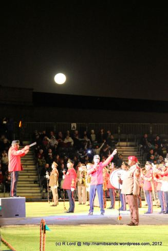 "Cpl Godfrey Rahube of the SA Army Band Cape Town sings ""Thank you for the music"" as the full moon rises behind him"