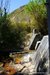 We find welcome shelter from the hot sun next to a small weir