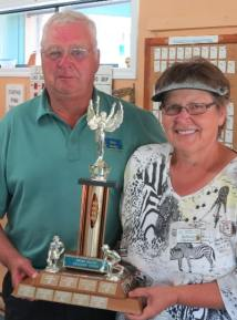 Mick Banks presents the trophy to Bernice