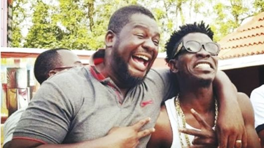 Shatta Wale and his Manager Bulldog
