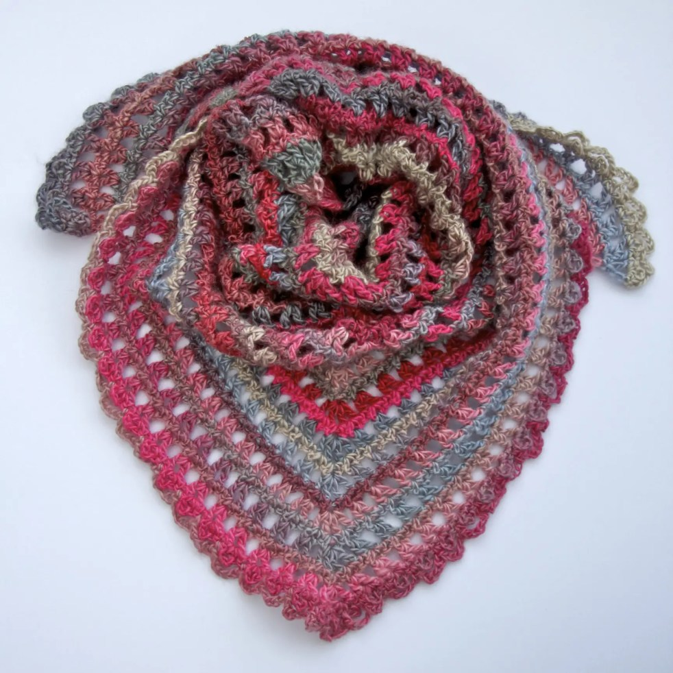 Candy Kisses Triangle Scarf free crochet pattern featuring Red Heart Unforgettable yarn