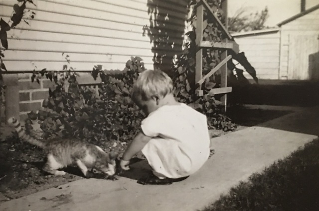 My father with a cat, Houston Texas