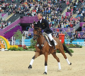 olympic event jump july 31 d700 no. 1385 michael jung and sam 300dpi