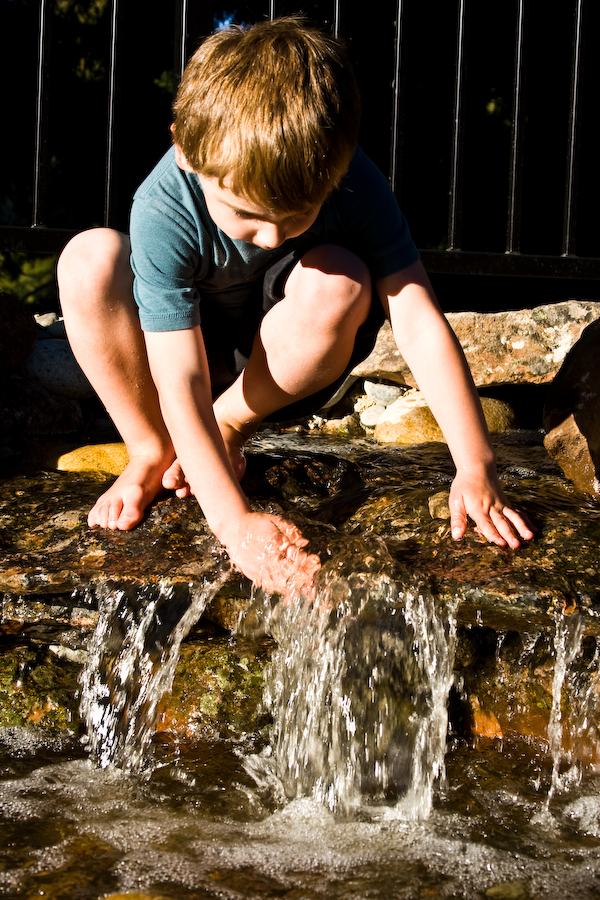 boy-plays-in-home-rock-waterfall