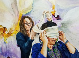 A young woman in glasses wraps a white scarf around the head of a dark-haired older woman. Both are wearing dark blue cardigans with over-sized white and lavender irises growing behind them.