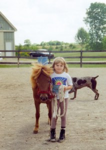 My youngest daughter Carli with her first horse--Snickers. She now has a quarter horse named Mojoe.