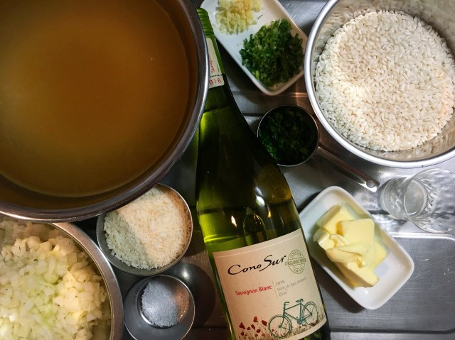 ingredients for parmesan risotto with white wine and herbs