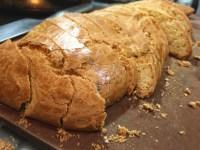 cut dough for almond biscotti with darjeeling tea liqueur