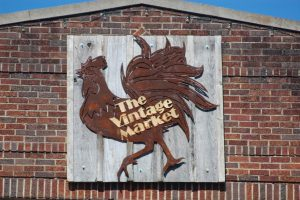 This sign depicts a rooster, unacceptable to some sign police.