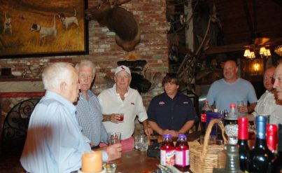 usinessman and philanthropist Bob Dunlap (left) talking to Billy Brewer, Jimmy Sandifer, Wes Ehrhardt, Preston Hansford, John Calvin Patterson and Lee Gardner.