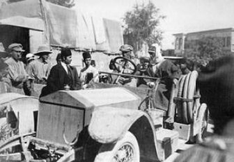 """ritish Army Colonel Thomas Edward Lawrence, sometimes called """"Lawrence of Arabia,"""" is seated in his Bedouin robes on the right in this photo. His driver is at the wheel one of the special """"desert buggies"""" Lawrence had Rolls Royce build for him. The cars were 1915 Rolls Royce """"Silver Ghosts Torpedo Tourers,"""" stripped down and beefed up for hard use. Among the first ever SUVs."""