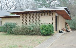 This is an exterior view of the building being re-purposed from a professional office to a private home. Note the double cantilevered roof.