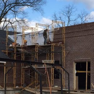 Brick masons at work on the west exterior wall of the new addition to the Union County Heritage Museum 2-25-16